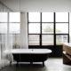 Badrumsinspiration - Elegant badrum med tadelakt, storformat, tassbadkar, mörkt trä, carrara, betong och svarta fönster