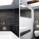 Badrumsinspiration - Mörkgrå klinker och vita väggar i badrum med vägghängd toalett och takfönster.